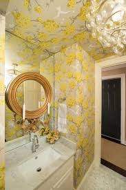 yellow and gray powder room with wallpaper on ceiling