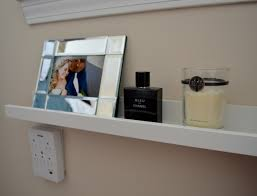 charging station shelf use a picture ledge shelf next to the bed as a charging station