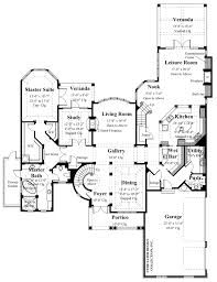 european house plans sater design collection home plans convenience for family living can be found indoors with two staircases a spiral staircase in the foyer and a back staircase off the kitchen nook