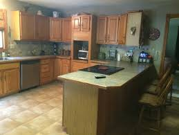 painting above kitchen cabinets help should i paint the wainscotting on my kitchen walls what color