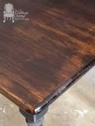 staining a table top staining on top of chalk paint to create that wooden look