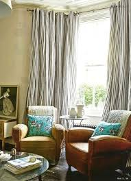 Blue Ticking Curtains Blue And White Ticking Drapes And Leather Club Chairs And Floral