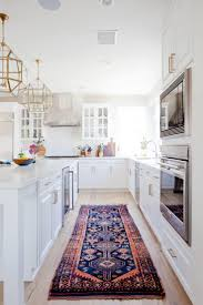 new traditional kitchen with bright gold and brass lanterns
