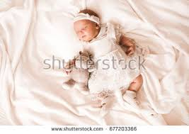 small baby sleeping on mothers stock photo 387995890