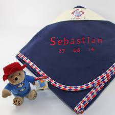 personalised blanket with paddington bear toy by mr mole blankets navy blanket showing block style embroidery