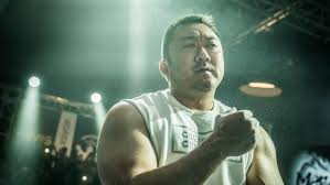 bureau d ude b on arm s ma dong seok flexes muscles in chion variety