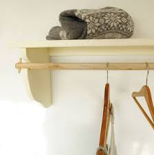 vintage styled wooden clothes rail with top shelf by seagirl and