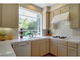 beige kitchen cabinets beige painted oak cabinets kitchens