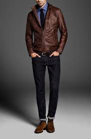 rock a brown leather er with navy jeans to create a great weekend ready look