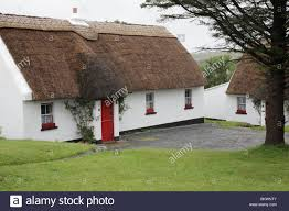 Thatched Cottage Ireland by Traditional Thatched Cottage With Red Door In Tully Cross In Stock
