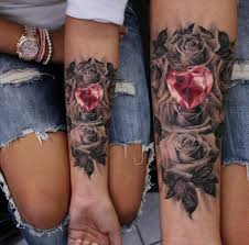 heart and flowers tattoo 69 heart warming sister tattoo ideas flower tattoos three