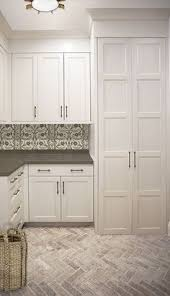 Pinterest Laundry Room Cabinets - laundry room i love the subtle under cabinet hanging rods very