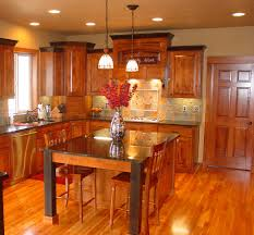 affordable custom cabinets showroom thumb kitchen traditional style rustic maple dark color raised panel custom wood hood island with accent