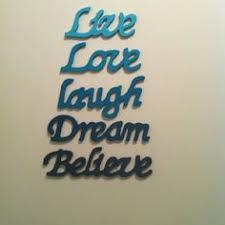 wooden word wall by dassie notonthehighstreet
