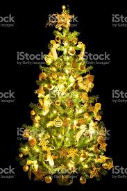 christmas tree decorated with golden color with the light on a