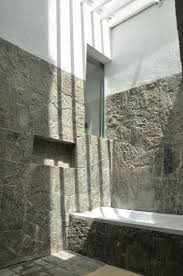 architecture natural stone bathroom wall in dark color with white