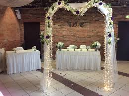 wedding flower arches uk ivory ceremony arch with drapes fairy lights and garlands of