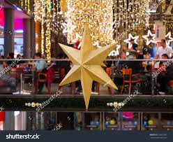 christmas star decoration inside shopping center stock photo