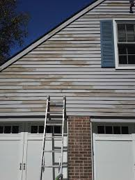 peeling solid color stain on cedar siding painting in partnership