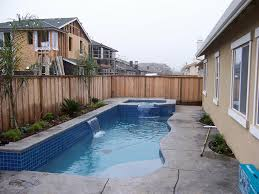 small swimming pools for backyards with travertine tiles ideas and