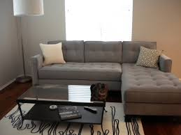 gray canvas tufted sectional sleeper sofa with double armrest and