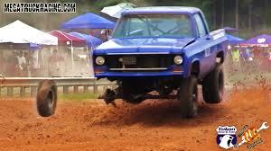 mud racing truck falls apart but keeps racing crowd goes wild