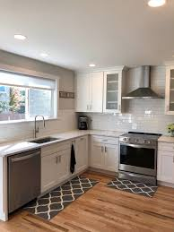 white shaker kitchen cabinets wood floors white shaker kitchen cabinets with wood floors page 1