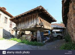 land rover wooden traditional raised wooden barn in espinama cantabria spain with