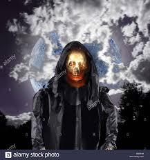 evil skull demon ghost with full moon on halloween night stock