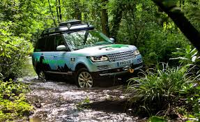land rover water the 2015 range rover hybrid expensively green