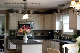 Above Kitchen Cabinet Ideas For Decorating The Top Of Kitchen Cabinets By Terrie