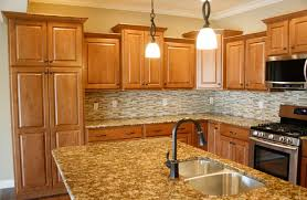 what color countertop looks best with honey oak cabinets