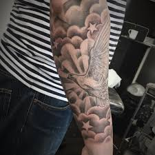 sleeve finished with clouds and healed dove and