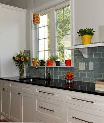 white kitchen cabinets subway tile backsplash black pearl granite