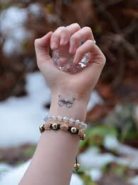 butterfly wrist raindrops of sapphire