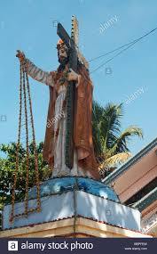 statue of jesus christ carrying a cross in kerala india stock