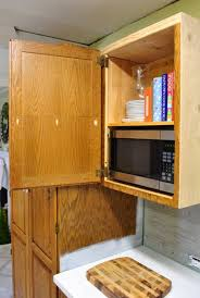 cutting kitchen cabinets hanging a clipboard in a cabinet to organize takeout menus