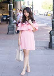 pink ruffle dress just a tina bit