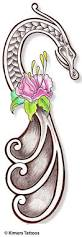 celtic dragon with pink flower tattoo design