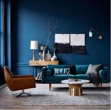 deep blue walls and teal sofa with warm tones blue livingroom