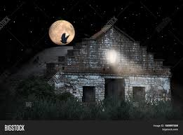 halloween scenery with old house crow sitting on the roof of the