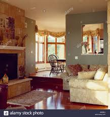 Corner Sofa In Living Room by Traditional Corner Sofa In Front Of Fireplace In Livingroom With