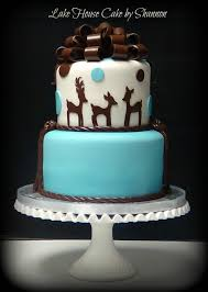 its a boy baby shower cake baby blue royal blue and gold baby