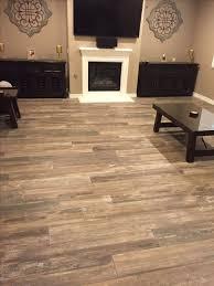 Tiling On Concrete Floor Basement by Best 25 Wood Like Tile Flooring Ideas On Pinterest Tile Looks