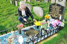 grieving catches grave robber after sewing tracker inside