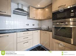 modern timber kitchens modern wooden kitchen with silver appliances royalty free stock