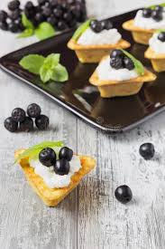 canapé cottage canape with cottage cheese and black berries of mountain ash stock
