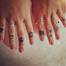 girls showing finger tattoo designs photo 2 photo pictures