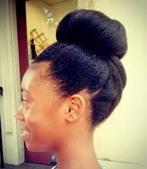 curly hair in high bun with bang 50 cute updos for natural hair