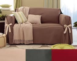 couverture canapé housses fauteuil et canapés bicolores à nouettes becquet
